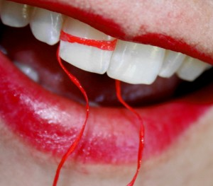 Free_Macro_White_Teeth_With_Dental_Floss_and_Red_Lipstick_Creative_Commons_509495525-300x263.jpg